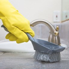 janitor scrubbing sink with brush