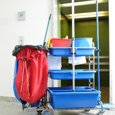 janitorial cart with cleaning supplies